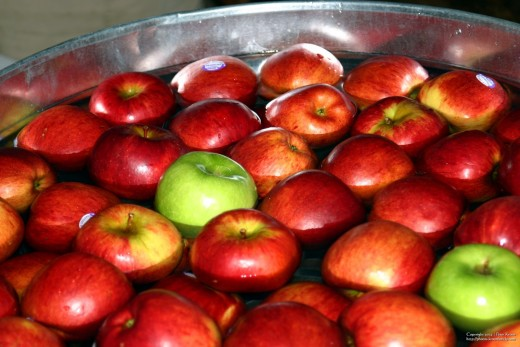 When bobbing for apples, to avoid too many germs being shared, don't have the kids eat their apple until it has been washed first