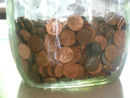 Just like this jar of pennies, getting out of any debt that you have takes time, and a means to save money where you can.