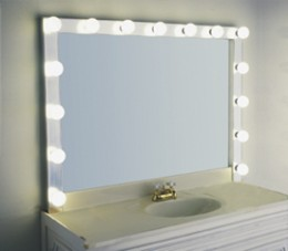 The classic vanity mirror with peripheral light bulbs is perfect for applying makeup