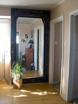 A large mirror can extend the perceived size of a room