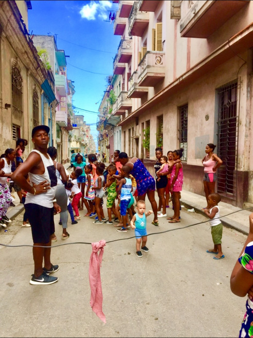 Children dancing to the rhythms of salsa music.