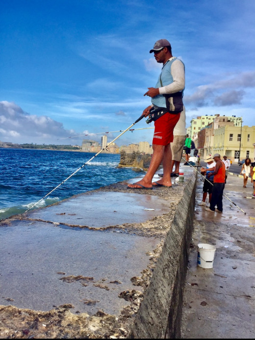 Fishing from the sea wall along Malecón.