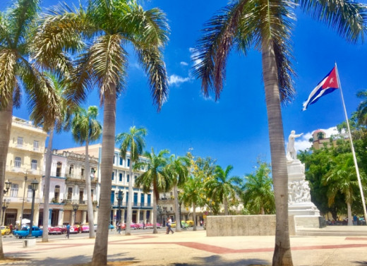El Parque Central in Havana Vieja. Beautiful architecture, American classical cars and a statue of José Marti, a fighter and symbol for Cubas independence from Spain.