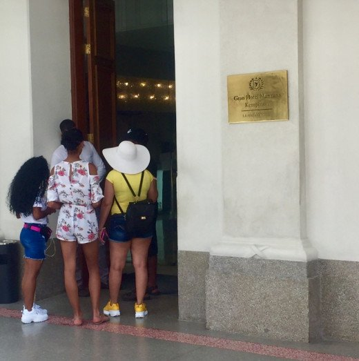 Tourists outside a luxury hotel in the heart of Havana.