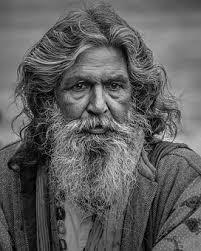 Man with grey hair and beard