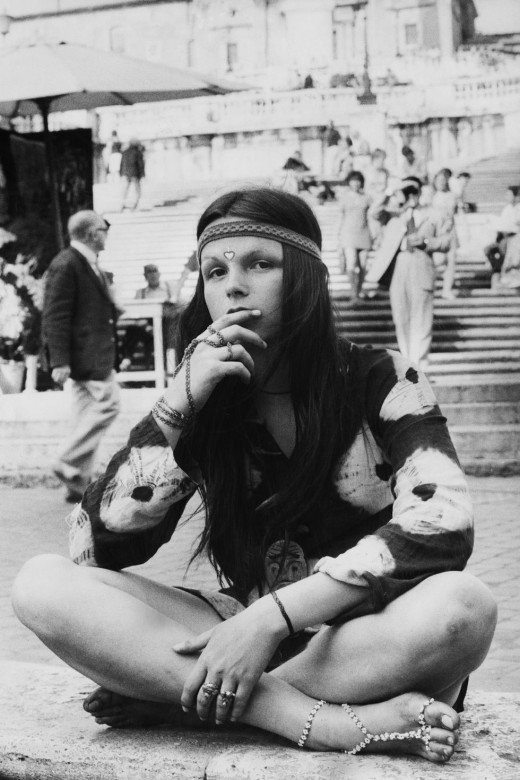 A young hippy wears tie-dye in the 60s
