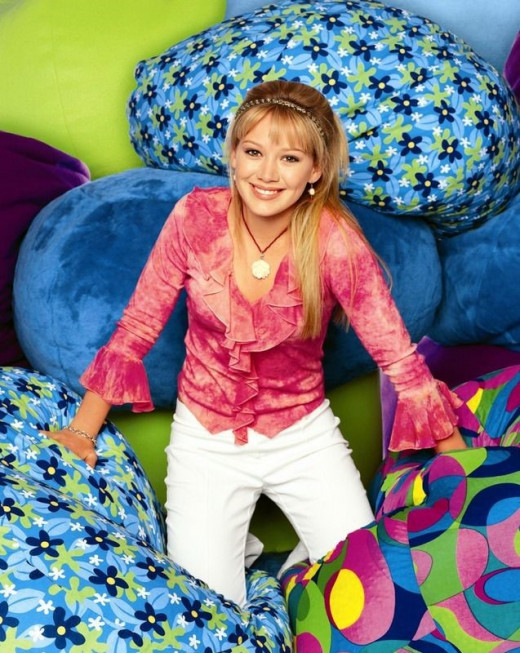 Hillary Duff wears tie-dye for the cover photo of her hit show – Lizzy McGuire.