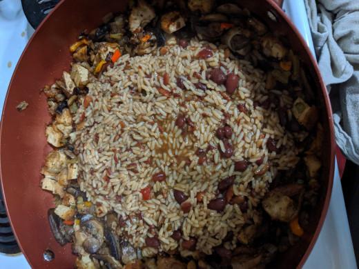 dump rice onto finished vegetables