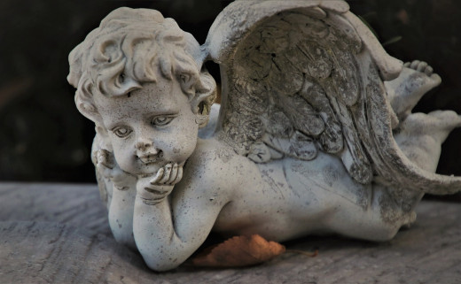 """This angel's eyes say it all, """"God doesn't love anyone but himself."""""""