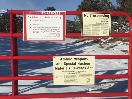 Warning signs at the perimeter fence of the National Laboratories in Los Alamos, New Mexico.  You will see numerous signs like these on your way to Bandelier.