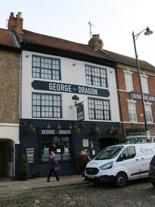 The George & Dragon now, car parking problems outside, a recently built halt over a mile out of town...