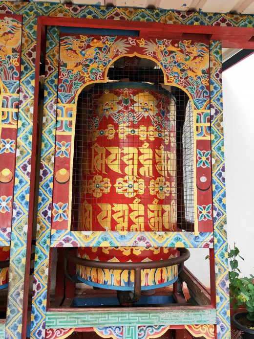 A stationary prayer wheel
