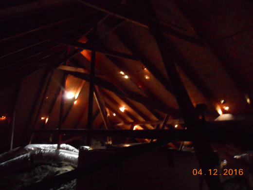 Picture from inside attic showing how hail came through the roof