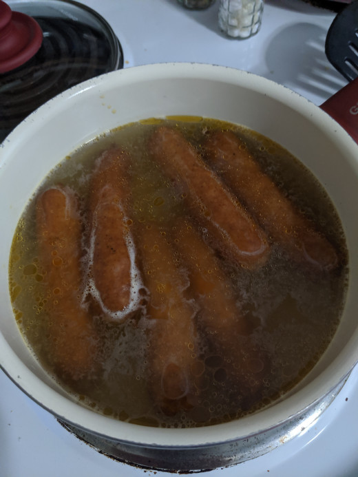 Sausages, water to cover, bring to a boil, reduce heat until internal temperature is 165 degrees