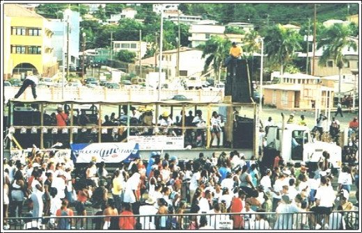 Jouvert crowds around one of popular bands on flatbed