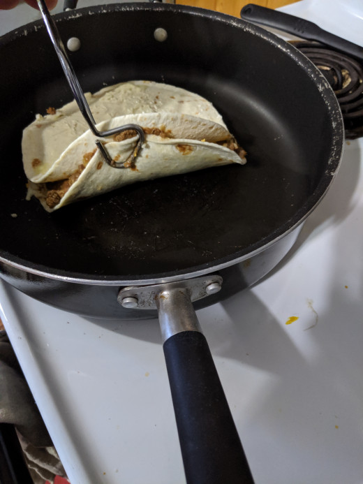 Lift up with tongs to check for browning