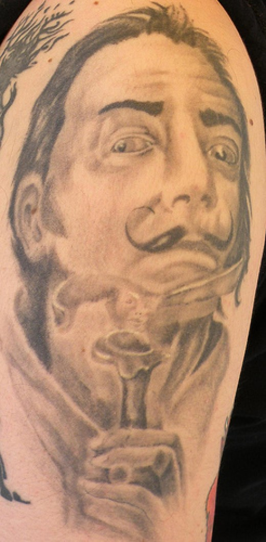 The portrait tattoo of Salvador Dali below has a similar feel to the one