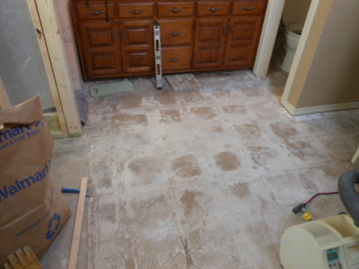 Floor tiles removed after a long and painful (sore muscles) ordeal.