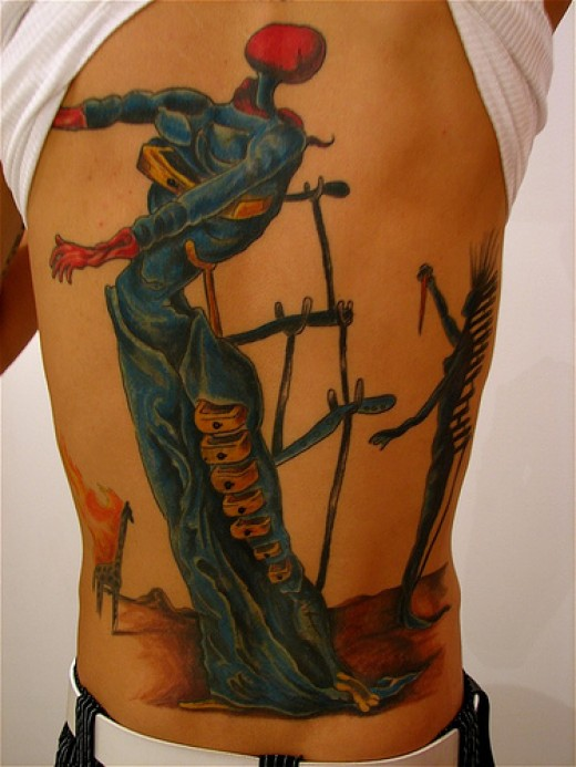 Great back tattoo influenced by Salvador Dali