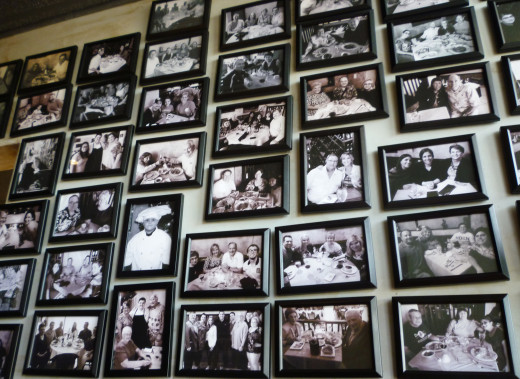 Photos of happy diners on entrance wall at Sapore Ristorante Italiano
