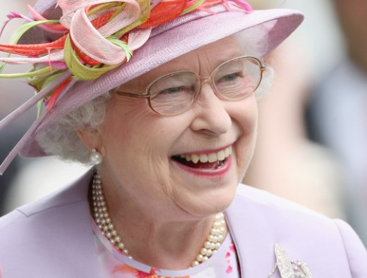 HM Queen Elizabeth II laughs in the parade ring on day four of Royal Ascot 2009 at Ascot Racecourse in Ascot, England.  ( CHRIS JACKSON, GETTY IMAGES / June 19, 2009 )