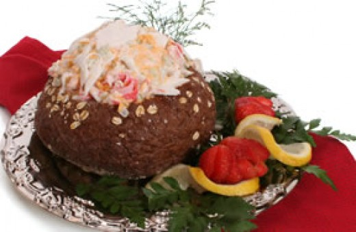 Crab Dip Being Served In A Bread Bowl