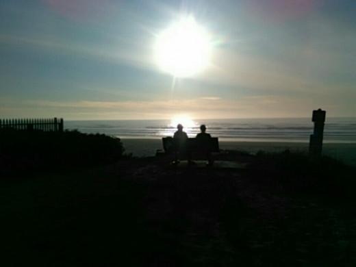 Elderly couple on a bench, Cannon Beach, Oregon.