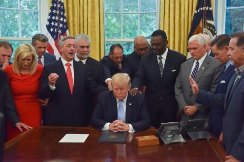 Pastors and the Vice President praying over President Trump - (Jahi Chikwendiu/The Washington Post article 2020/02/14)