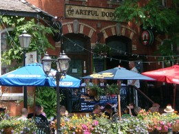 This shot captures a sample of several outdoor umbrellas in use at this great looking cafe-patio-bar. Photo by http://www.flickr.com/photos/soho_lass/2667721067/