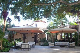 This nice looking villa-style patio is using 2 offset style outdoor umbrellas.  Photo by http://www.flickr.com/photos/offset_umbrellas/3415795419/