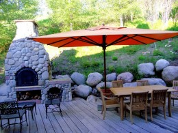 A great patio umbrella on a beautiful deck.  Photo by http://www.flickr.com/photos/34024727@N07/3170011665/