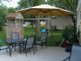 Here is one of those offset patio umbrellas mentioned.  Photo by http://www.flickr.com/photos/briancovey/3587044249/