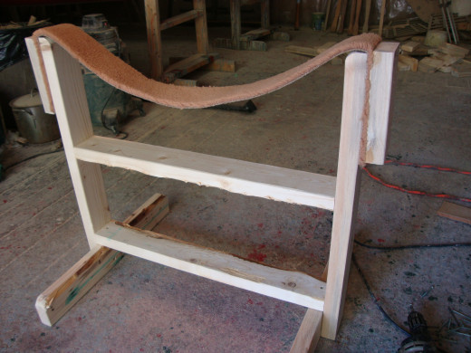 This is a home built canoe cradle. It's used to support the canoe in the upright position for working on the inside.