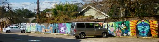 Graffiti murals art on fencing around Cecil's Pub