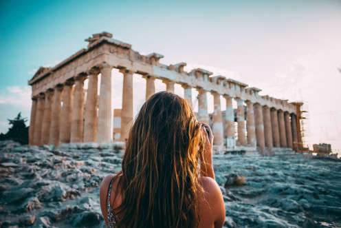 A woman is exploring the city of Athens where the band Septicflash was formed.