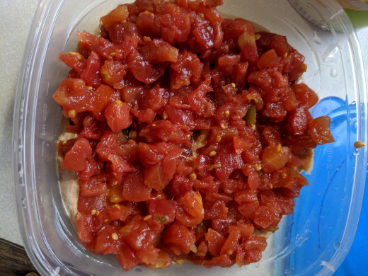 add drained tomatoes on top of chip dip