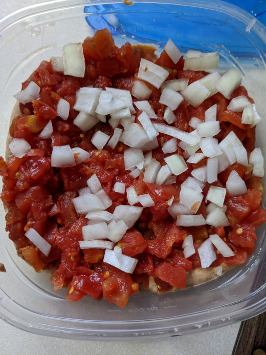 add to top of tomatoes