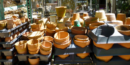 Regular clay pots in addition to numerous decorative ones