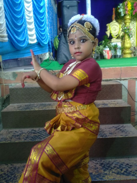 A  UKG  girl performing Bharat Natyam at School function