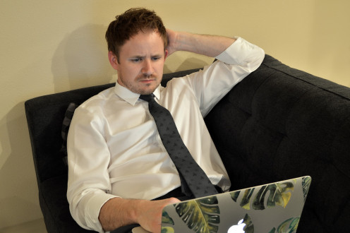 A sedentary lifestyle is what happens to people that do not exercise regularly. They spend most of their day sitting down just as this businessman is doing in this photo.