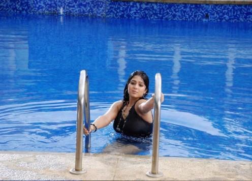 Charmi in a swimsuit