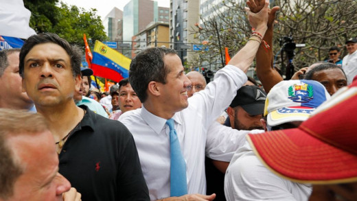 Opposition political leader Juan Guaido greets supporters during a march before it was blocked by police in Caracas, Venezuela, Tuesday, March 10, 2020. Guaido called for the march aimed at retaking the National Assembly legislative building, .....