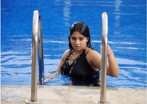 Charmi in a pool