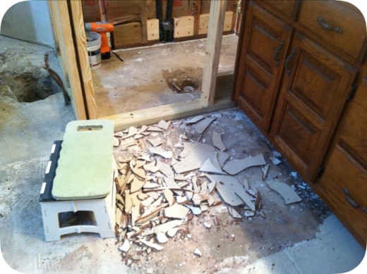 Breaking up tiles and chiseling out tiles