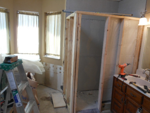 Shower wall with concrete fiberboard attached to the inside walls.