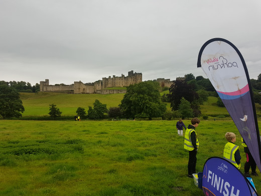 The Pastures parkrun with the backdrop of Alnwick Castle