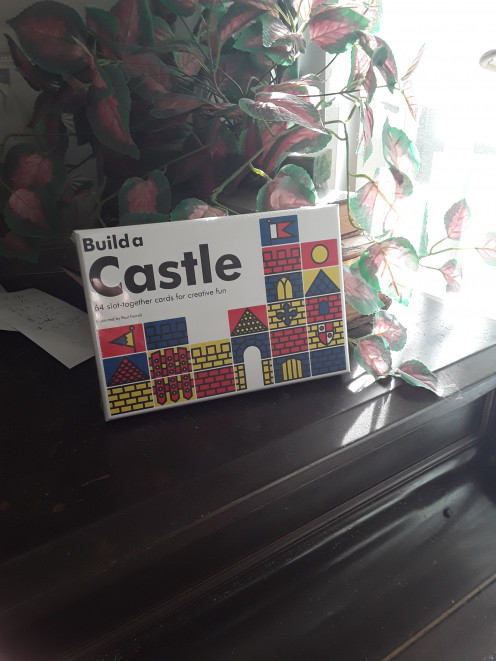 Hands-on card activity with shapes and cards that fit together to build the castle