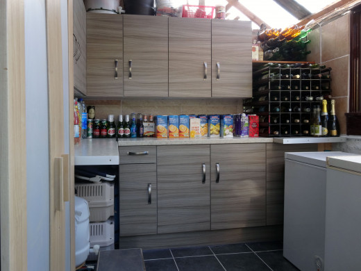 My wife's food store after I replaced the temporary 18mm plywood shelving for proper kitchen units; with a piece of that plywood subsequently being recycled to make the 4-drawer unit.