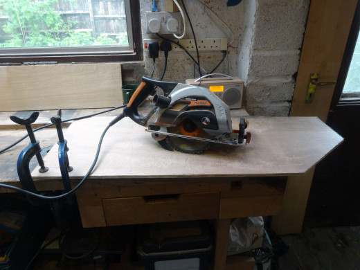 Cutting the side panels to size with a circular saw.
