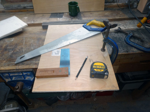 Squaring up one end, with square, and cutting straight with a handsaw.